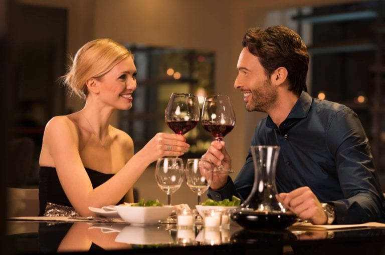 couple enjoying romantic dinner restaurant